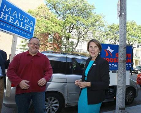 Communications director David Guarino is with Maura Healey, his candidate for attorney general, on Tuesday, Sept. 9, 2014.
